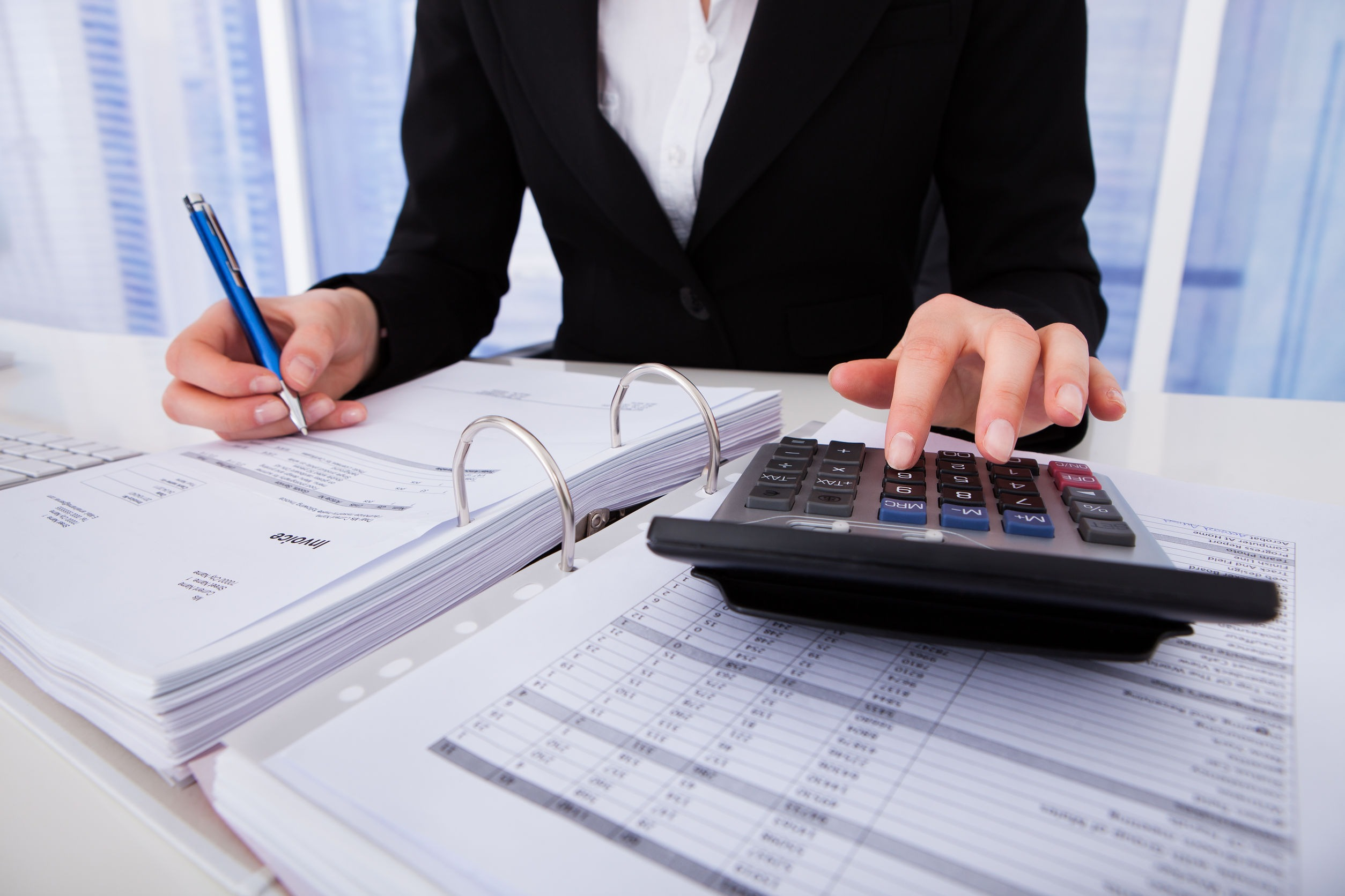 Bookkeeping Accountant with calculator